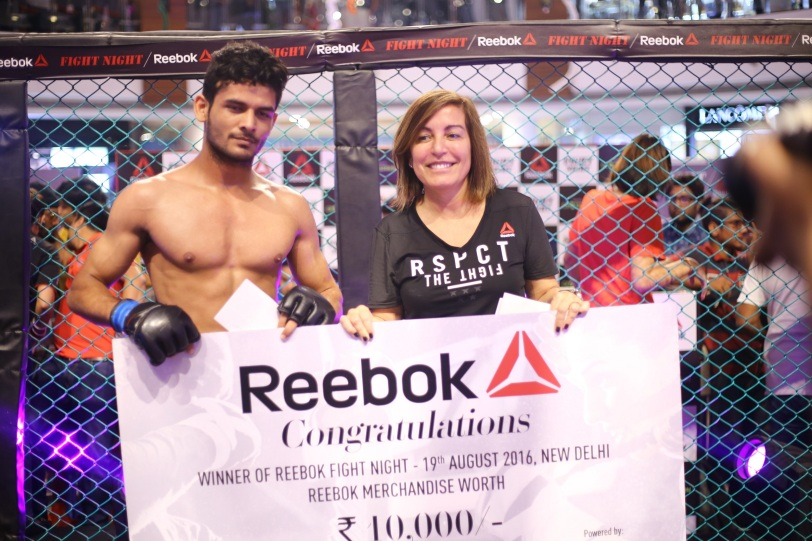 A Reebok Fight Night winner with Silvia Tallon, Senior Marketing Director, Reebok India